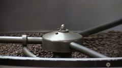 Roasted coffee beans in coffee roaster Stock Footage