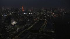 Aerial illuminated Metropolis city night Tokyo Tower Bay Odaiba Japan - stock footage
