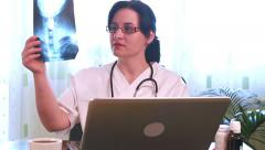 Doctor giving the results of radiography on line Stock Footage