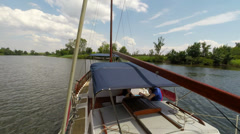 Pleasure yacht sails on the river, the camera is fixed on the bow of the yacht 4 Stock Footage