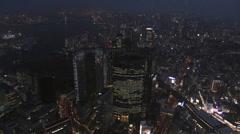 Aerial illuminated Metropolis city night Tokyo Bay Rainbow Bridge Odaiba Japan - stock footage