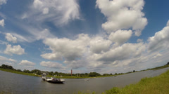 Ferryboat across river Rhine between Wageningen and Opheusden - time lapse Stock Footage