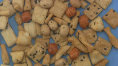 Rice crackers on a blue background. - stock footage