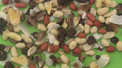 Tropical dried mixed fruit on green background. Stock Footage