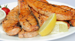 Dish of fried fish.Trout steak with sauce. Stock Footage