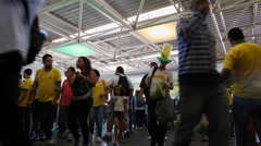 Brazilians Fans walk to enter to the match Brazil x Croatia in 2014 World Cup Stock Footage
