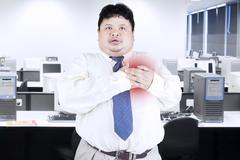 Obesity businessman getting heart attack Stock Photos