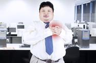 Stock Photo of obesity businessman getting heart attack