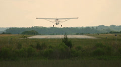 Tail Dragger Single engine airplane landing in slow motion Stock Footage