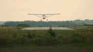 Stock Video Footage of Tail Dragger Single engine airplane landing in slow motion
