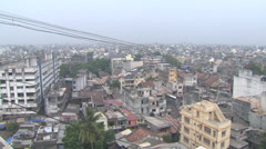 Top shot panorama of Surat, seen through a tangle of power cables Stock Footage
