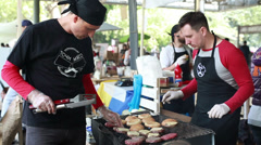 Street Cooks fry the burgers Stock Footage