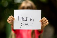 girl with thank you sign - stock photo