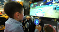 boys playing on the slot machines at race in children's entertainment center Footage