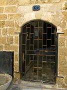 Rusty old iron lattice door Stock Photos