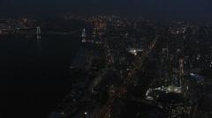 Aerial illuminated Metropolis city night Tokyo Bay Rainbow Bridge Odaiba Japan Stock Footage