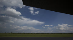 Time Lapse -  Crazy Clouds at a Air Field Stock Footage