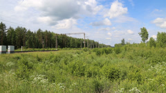 Railroad with train in the summer on a background of green grass in the summer i Stock Footage