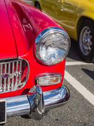 Headlight of vintage classic cars taking part in a trail run in north wales Stock Photos