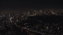Aerial illuminated Metropolis city night Tokyo Bay Rainbow Bridge Odaiba Japan Stock Footage