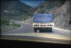 SUPER 8 MEXICO 1979 cadillac driving on the road behind a truck 2 Stock Footage