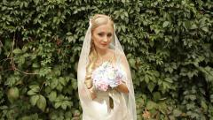 The bride at the ivy-covered walls Stock Footage