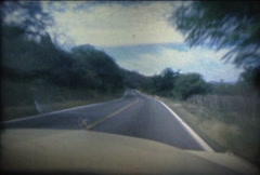 SUPER 8 MEXICO 1979 cadillac driving on the road Stock Footage