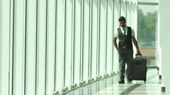 4K & HD resolutions: indian man walks and phones in the airport terminal Stock Footage
