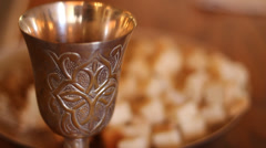 Rack-focus shot of bread & wine for Communion - stock footage