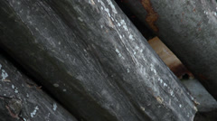 Stack of logs, fuel, winter supplies, firewood, tree trunk pile, tilt up Stock Footage