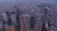 Aerial dusk Tokyo city Skyscrapers Metropolitan Government Building Japan Stock Footage