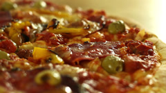 Close-up of a spinning pizza HD Stock Footage