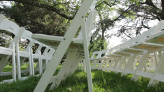 White folding chairs at outdoor wedding Stock Footage