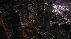Aerial Metropolis Tokyo night illuminated skyscrapers transport Financial Stock Footage