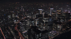 Aerial Metropolis night Tokyo illuminated skyscraper Hakozaki interchange Japan Stock Footage
