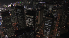 Stock Video Footage of Aerial Metropolis close up Tokyo night illuminated skyscrapers  travel Japan