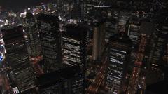 Aerial Metropolis close up Tokyo night illuminated skyscrapers  travel Japan Stock Footage