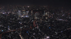 Aerial Metropolis Tokyo illuminated skyscrapers city Financial Business District - stock footage