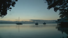Predawn on a sheltered harbor Stock Footage