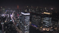 Stock Video Footage of Aerial Metropolis illuminated skyscrapers Tokyo Tower Business District Japan