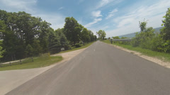 Motorcycle POV in Summer Resort Town #1 Stock Footage
