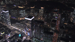Aerial illuminated Metropolis Tokyo National Rail station Business district Stock Footage