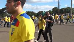 Ecuadorians and Swiss fans after soccer game in World Cup Stock Footage