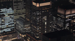 Aerial Tokyo close up illuminated skyscrapers Shibuya structure Business Stock Footage
