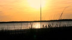 Family silhouette sunset beach sailboat mast Stock Footage