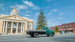 Vehicles Driving infront Henderson County Courthouse in Hendersonville, NC - stock footage