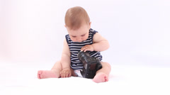 Hi Tech Baby. Boy playing with a photocamera against white background Stock Footage