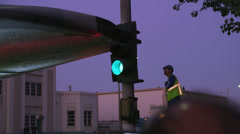 Shuttle Endeavor crosses intersection worker checks clearance HD Stock Footage
