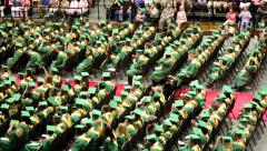 high school graduates toss hats 1 - stock footage