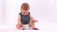 Hi Tech Baby. Boy playing with a tablet against white background Stock Footage